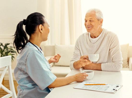 nurse talking with an elder man