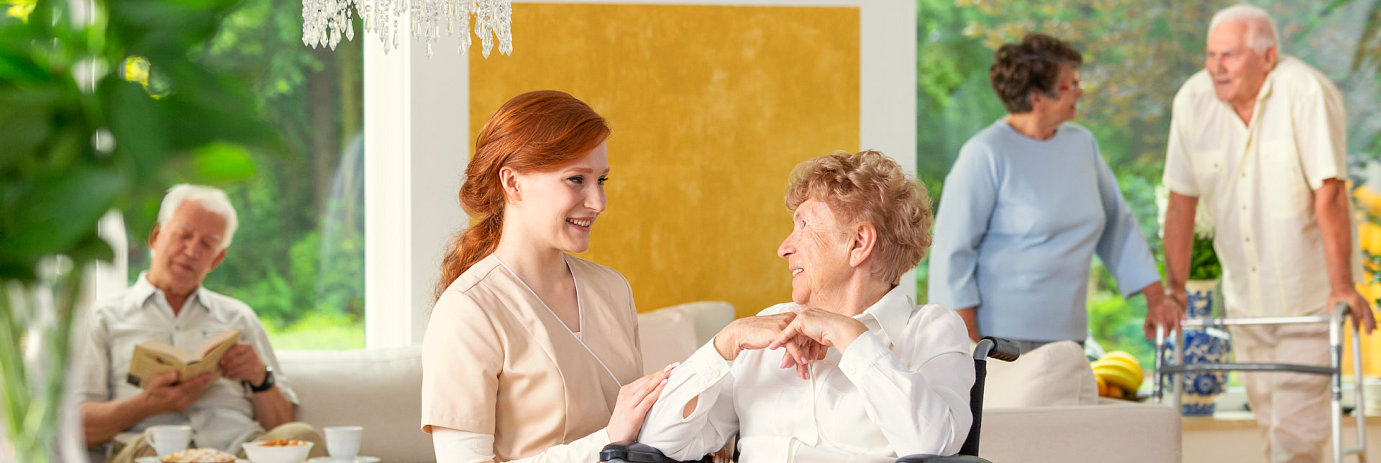 caregiver talking to an elder woman